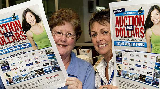 PRIZES UP FOR GRABS: Chronicle staff Judy Janetzki (left) and Gail Telford are excited about Auction Dollars.