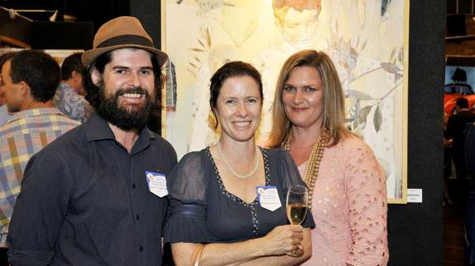 Feature artist Damien Kamholtz with Robin Thompson (centre) and Robyn Geary at the opening night of the Toowoomba Grammar School Art Show.