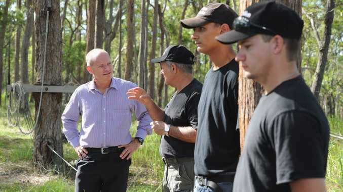 Owner of Hard Yakka Bob Davis shows Premier Campbell Newman around the property.