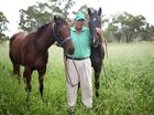 Tony McMahon with two of the horses (Cought Eloping and Craiglea Convict) on his Stanwell property. Photo Allan Reinikka / The Morning Bulletin