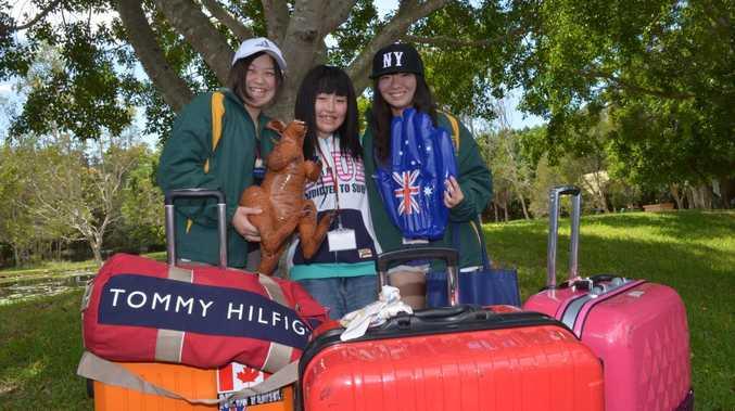 SOME JOY: Misaki Iwabuchi, Ami Fujino and Megumi gato are three of 25 Japanese students visiting the Sunshine Coast from the tsunami affected Fukushima area. Photo: John McCutcheon / Sunshine Coast Daily