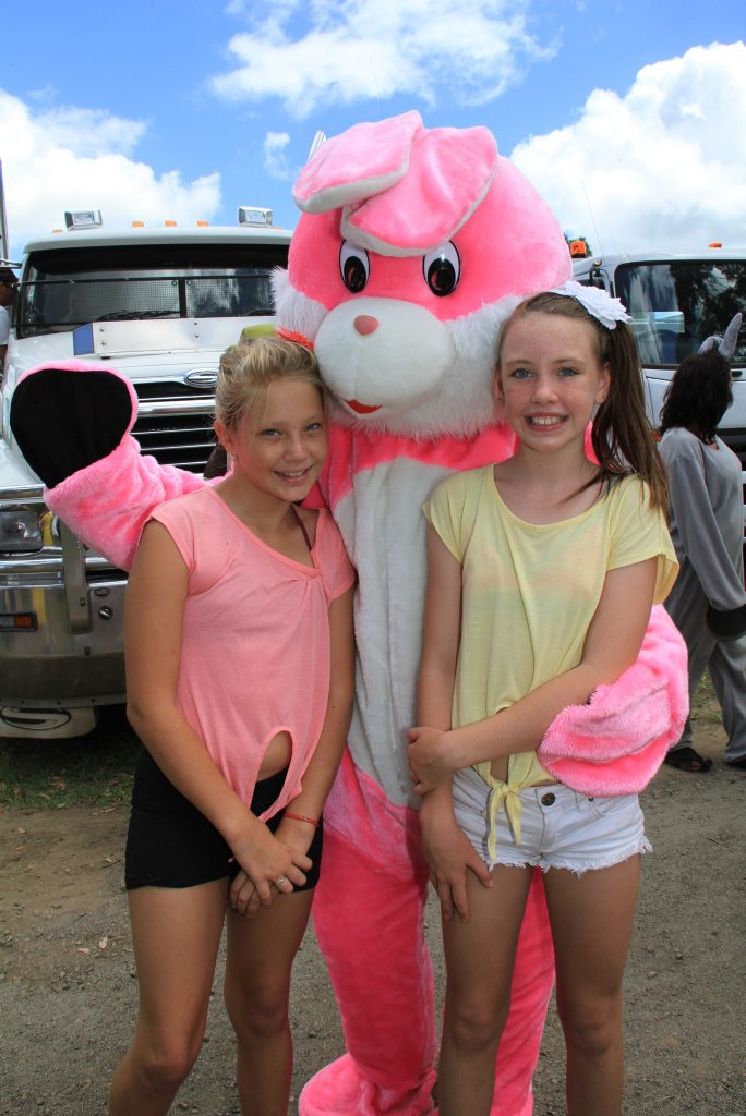 BIG HUGS: Brittany Wardley and Kayla D'arcy meet the Easter Bunny. Photo: Paul Donaldson / NewsMail