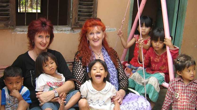 Tracey Golder and Mumma Ruth with some of the Love in Action kids in Cambodia.