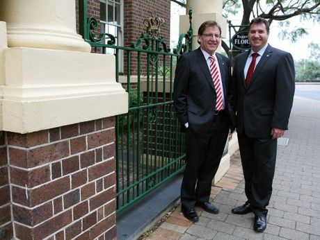 QHC Chair Professor Peter Coaldrake (L) and Minister for Environment and Heritage Protection Andrew Powell (R) outside the former Naval Offices in Brisbane