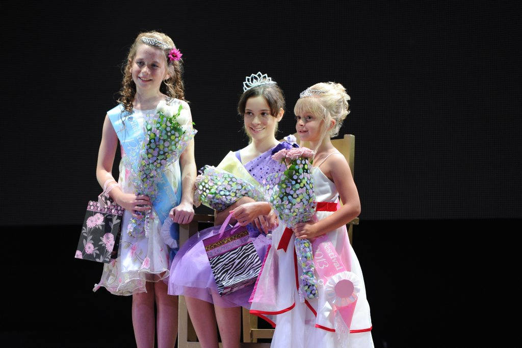Princess winner Ellie Wyatt, Junior Queen winner Mackenzie Price and Junior Princess winner Paige Stokes.