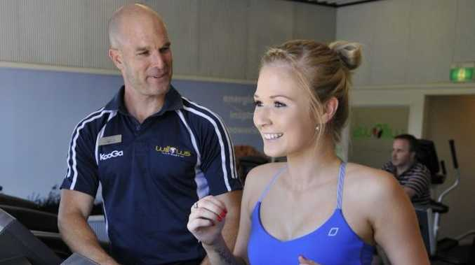 Craig Neilan from Willows Health & Lifestyle Centre with member Grace Craymer.