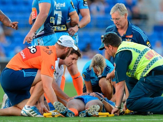 Ashley Harrison of the Titans is knocked out after being hit late by Richie Fa'Aoso of the Sea Eagles during the round three NRL match between the Gold Coast Titans and the Manly Sea Eagles at Skilled Park on March 23, 2013 in Gold Coast, Australia.