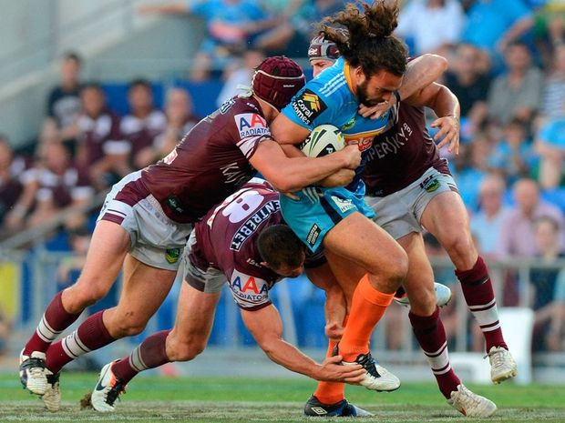 Ryan James of the Titans attempts to push through the defence during the round three NRL match between the Gold Coast Titans and the Manly Sea Eagles at Skilled Park on March 23, 2013 in Gold Coast, Australia.