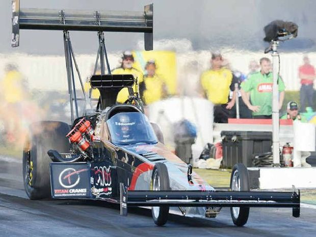 FIRED UP: American racer Larry Dixon is ready to crank up his Rapisarda team machine at Willowbank Raceway.