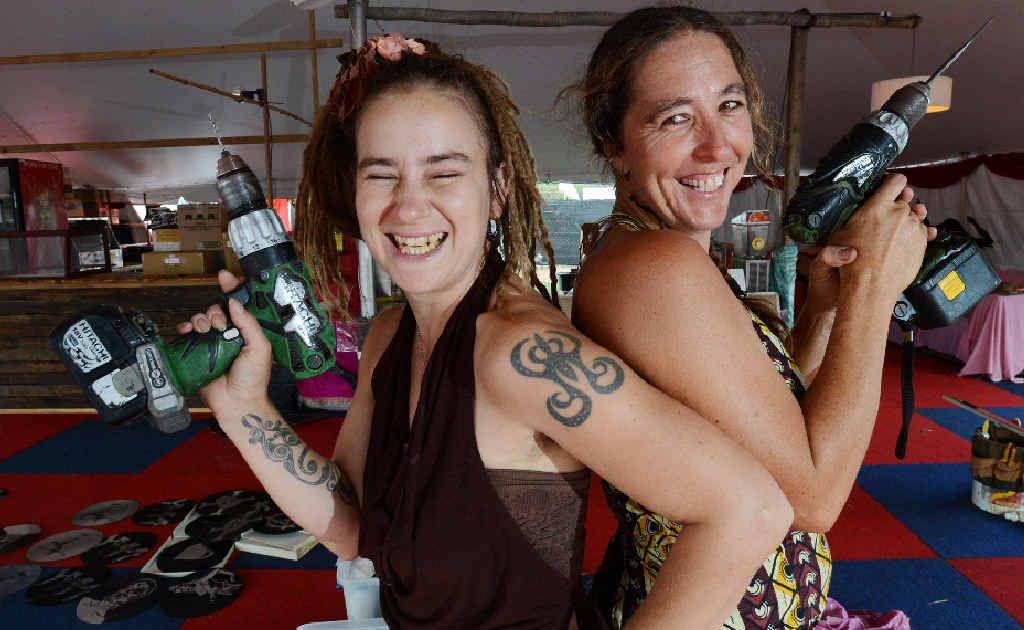 GOT THE DRILL?: Decor designer Emma Woodburn and Christina Covinton from Hari Har Chai spruce up the Cavanbah food hall at Bluesfest.