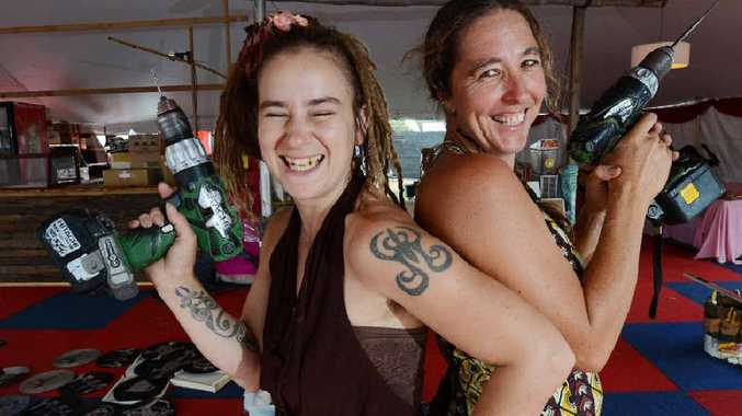 GOT THE DRILL?: Decor designer Emma Woodburn and Christina Covinton from Hari Har Chai spruce up the Cavanbah food hall at Bluesfest.