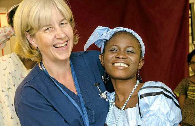 Mercy Ships volunteer nurse Robyn Ferguson and fistula patient Mamata.