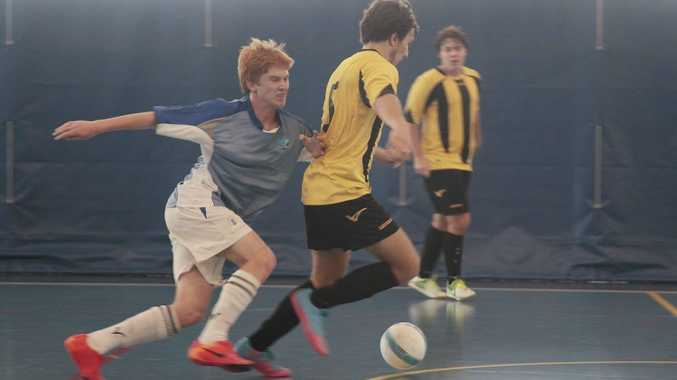 Futsal at goonallabah sport centre.Collo vs DBS Arlen Horton (in blue) and Jonathan See (in yellow)