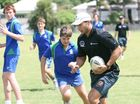 Kids muster to see Broncos players at coaching clinics
