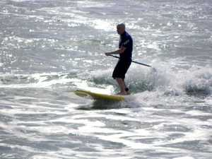 Peter Furler stand up surfing off Sunshine Coast