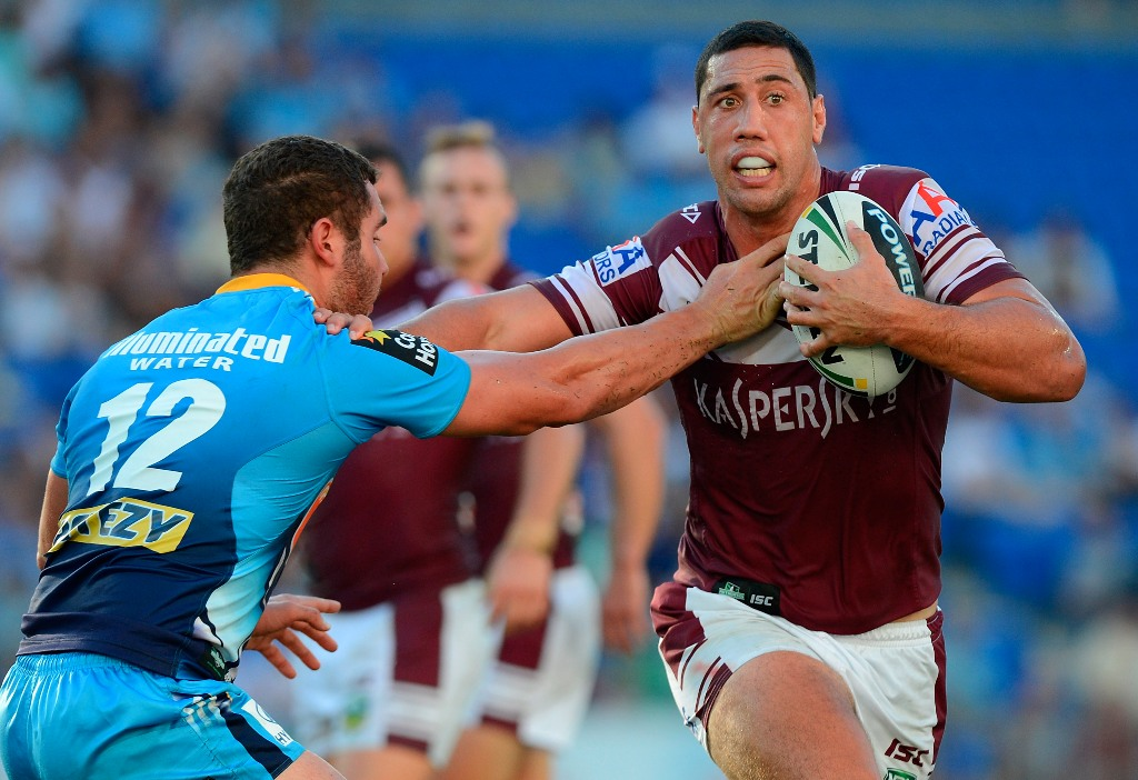Brent Kite of the Sea Eagles pushes away from the defence during the round three NRL match between the Gold Coast Titans and the Manly Sea Eagles at Skilled Park on March 23, 2013 in Gold Coast, Australia.