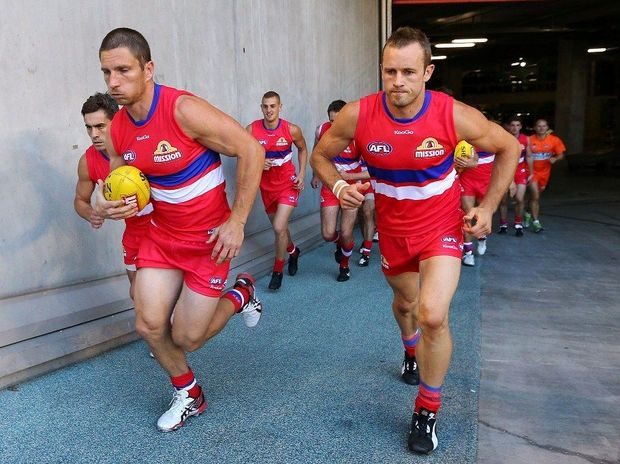 Matthew Boyd (L) and Daniel Cross lead the Western Bulldogs out during the round two NAB Cup AFL match between the Western Bulldogs and the Hawthorn Hawks at Etihad Stadium on March 1, 2013 in Melbourne, Australia.