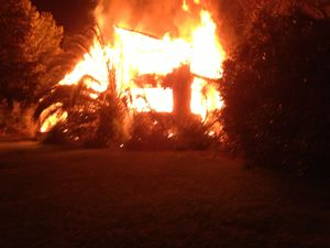 Woman charged over house fire at Nana Glen