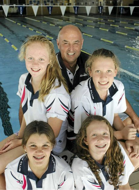 DELAYED RECORD: Madeline Nilon, 14, Trinity head swimming coach Ken Malcolm, Georgia Callaghan, 15, Karla Gilmore, 15, and Samantha McKenna, 15, found out by mail last week that they had broken a state relay swimming record at the State Age Championships at Sydney Olympic Aquatic Park in January.