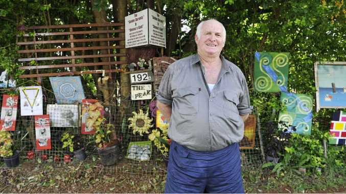 ON SHOW: Bruce Morrow with his artwork displayed outside his home in Alstonville.