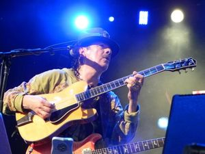 Carlos Santana shows security the door to let party begin