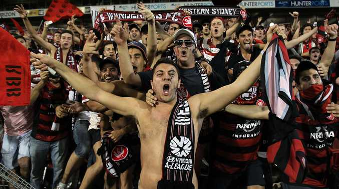 Wanderers fans celebrate after defeating the Jets during the round 27 A-League match between the Newcastle Jets and Western Sydney at Hunter Stadium.
