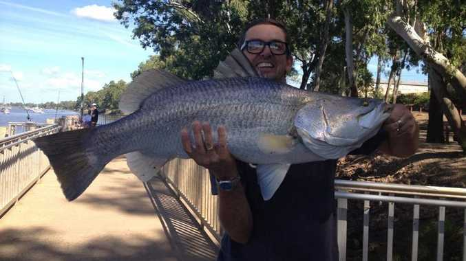 Kevin Whittington with the 9.9kg barramundi he and his 9-year-old son landed in Rockhampton on Good Friday.