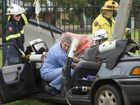 Medical staff and firefighters work to free the 28 year old woman trapped in her car on Lyndall St.