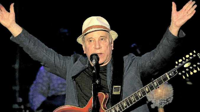 ABOVE: American songwriter and producer Paul Simon performs during the Timbre Rock and Roots concert on Friday March 22, 2013 in Singapore.