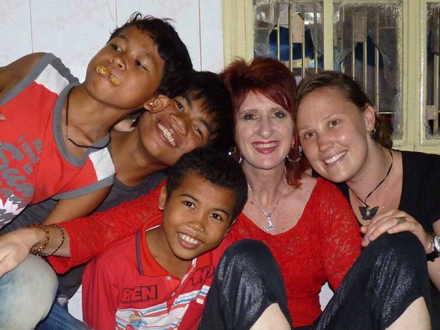 IN HIDING: Tracey Golder with some of the Love in Action kids in Cambodia.