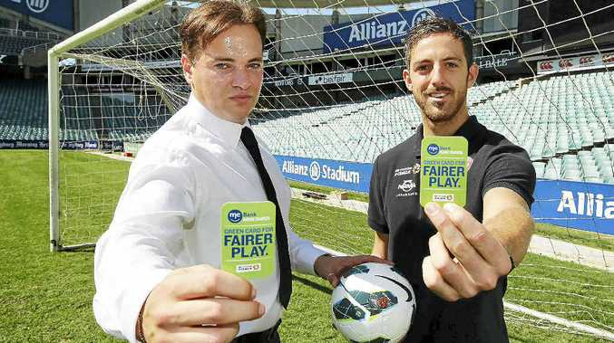 ALL FOR THE SENTIMENT: Former Socceroo Mark Bosnich and Western Sydney Wanderers reserve keeper Jerrad Tyson promote the ME Bank Green Card for Fairer Play Award at Sydney's Allianz Stadium last week.