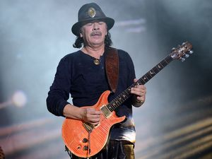 Santana sizzles through the rain on Bluesfest day 2