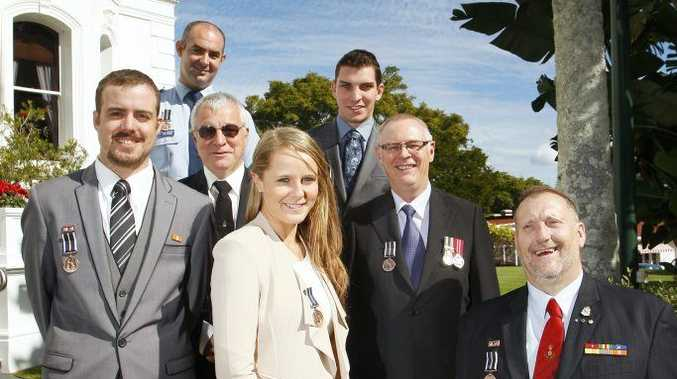 Royal Humane Society of Australia bravery awards recipients are pictured at Government House: from left, Brendon Weber of Yamanto, Senior Constable Jon Kirkman of Goodna, Andrew Shortland of Eastern Heights, Cassandra Broadfoot and of Newtown,Andrew Kelly of Bundaberg, Jon Klaebe of Flinders View and Jim Runham SC AFSM OAM of Flinders View.