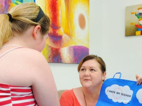 Psychologist Sonya McCall does some Secret Agent Society activities with her client as part of Autism Awareness Week.