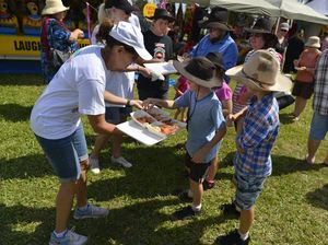 Festival goers happy to taste test free harbour prawns