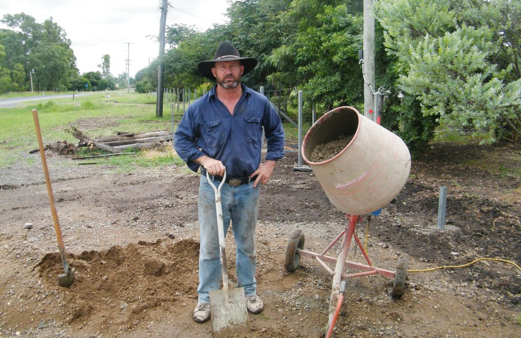 John McAlister fixing his Jambin property after the Australia Day floods this year.