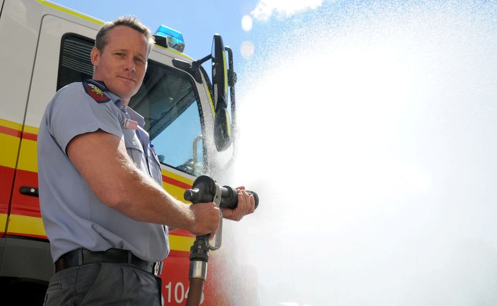 Gympie firefighter Cameron Ritchie helped rescue a kitten from a drain by using a fire hose to gently flush it out.