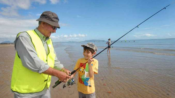 WAITING FOR A BITE: Glenn Fahy, of Mackay Recreational Fishers Alliance, gives his grandson Ned Stronarch some fishing tips at Shoal Point yesterday.