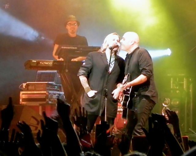 Kevin Max, lead singer of Audio Adrenaline, who used to be with the hit group dc Talk, joins Peter Furler on stage at Easterfest. Furler's former band Newsboys is now front by dc Talk's Michael Tait.