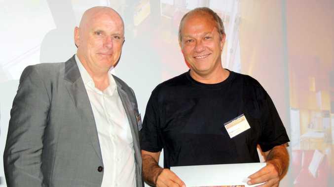 Australian Institute of Architects Queensland president Shane Thompson, left, presents the Sunshine Coast House of the Year award to Dragi Majstorovic