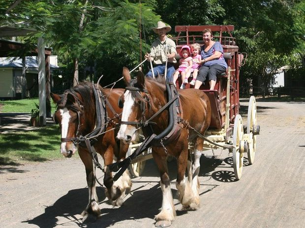L-R Ellie and Matilda Haggarty and Libby Ahern take a ride on the stage coach at the Heritage Village. Photo: Chris Ison / The Morning Bulletin