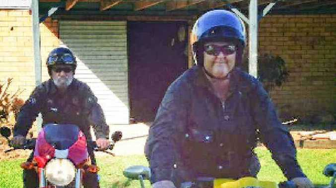 Stacey Heydon (front) and her husband Colin on their motorbikes.