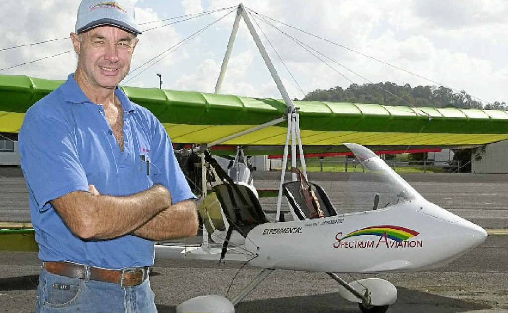 Wayne Fisher from Spectrum Aviation in front of one of his aircraft.