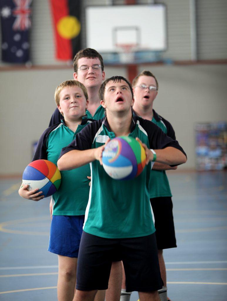 Michael Sedgwick having a go at basketball at Berserker State School. Photo Allan Reinikka / The Morning Bulletin