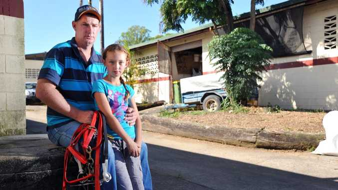 John Johnston with daughter Paige, 10, at Kenlyn Racing Stables, in front of the stables where three of his horses were electrocuted and killed. Photo: Iain Curry / Sunshine Coast Daily