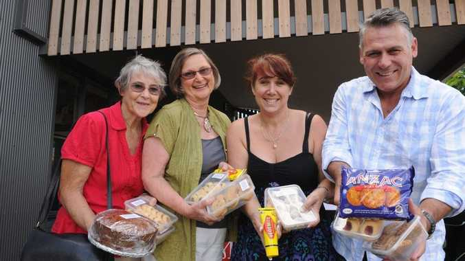 Cae Adams, Lyn Kelman, Rob and Fern Mesenger with some of the goods to go in the Anzac Hamper for the troops overseas.