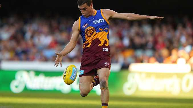 Tom Rockliff of the Lions in action during the round 14 AFL match between the Brisbane Lions and the Melbourne Demons at The Gabba on July 1, 2012 in Brisbane, Australia.