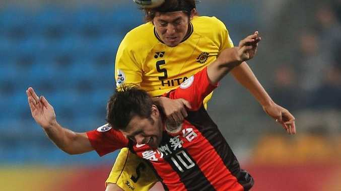 Zvjezdan Muslimovic (#10) of Guizhou Renhe competes for an aerial ball with Tatsuya Masushima of Kashiwa Reysol during the AFC Champions League match between Guizhou Renhe and Kashiwa Reysol at Olympic Sports Center on February 27, 2013 in Guiyang, China.