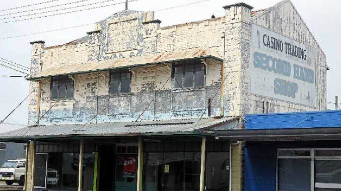 PETITION: A development application has been lodged with Richmond Valley Council to demolish the heritage-listed former Gray's Garage building in Walker St, Casino. The building's pressed metal facade is clearly visible.