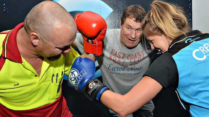 Joel Katthagen , left looks to be on the receiving end of some leather courtesy of City Fitness instructor Bonnie Elliott has Mick Pope tries to calm them. Photo Peter Holt / Daily Mercury